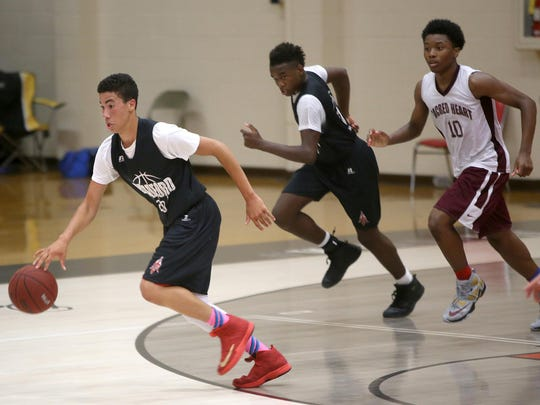 Bradford's River Street, left, handles the ball against Sacred Heart during a Union University basketball team camp at Fred DeLay Gymnasium on Wednesday.