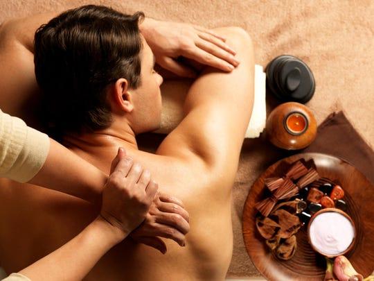 Man having a massage in spa salon