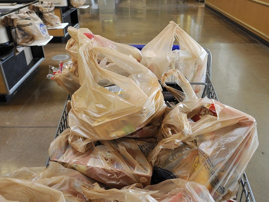 Annette Spain's bagged shopping is seen at the Kroger on University Parkway.