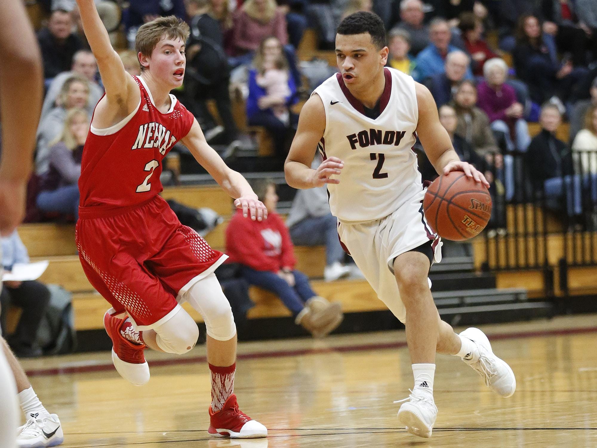 Caleb Goldstein of Fond du Lac drives to the basket against the Neenah defense Friday in Fond du Lac.