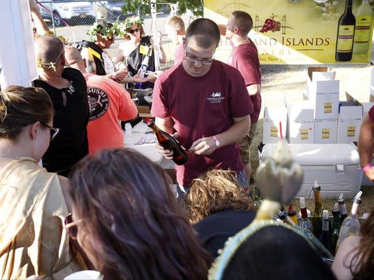A mob of wine enthusiasts crowd the Thousand Islands Winery booth last year at the Finger Lakes Wine Festival