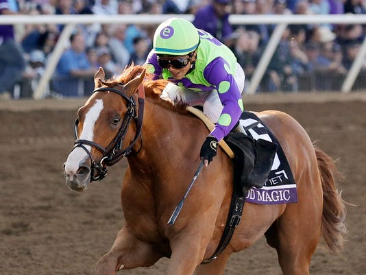 FILE - In this Nov. 4, 2017, file photo, jockey Jose Ortiz rides Good Magic to victory in the Sentient Jet Juvenile horse race at the Breeders' Cup in Del Mar, Calif. Good Magic, winner of the Breeders' Cup Juvenile and last year's 2-year-old champion, is among 360 3-year-old thoroughbreds made eligible during the early nomination period to compete in the Kentucky Derby, Preakness and Belmont stakes. (AP Photo/Gregory Bull, File)