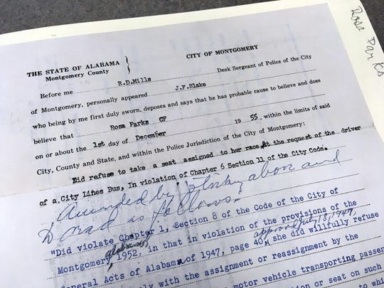 A court document filed after Rosa Parks' arrest for refusing to give up her bus seat to a white man on a bus is displayed at the archive of Alabama State University in Montgomery, Ala. The university is preserving court documents linked to the civil rights era that were found in a box at the county courthouse.