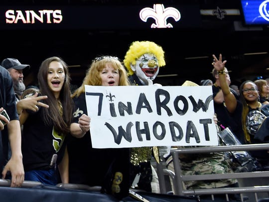 FILE - In this Sunday, Nov. 4, 2018, file photo, New Orleans Saints fans react after an NFL football game against the Los Angeles Rams in New Orleans. Here comes Who Dey vs. Who Dat. Say what? The Who Dat folks from New Orleans go head-on with the Who Dey fans in Cincinnati on Sunday. And don't ask which group first came up with its catchy phrase and odd rendering of the English language. (AP Photo/Bill Feig, File)