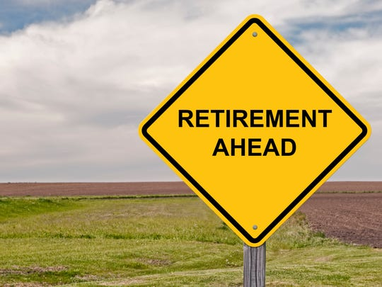 A yellow road sign that says retirement ahead.