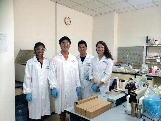 Rutgers Chemistry students (from left) Richa Rana, James Liu, Alexander Bahia and Shiri Nawrocki at work in a lab at Jilin University in China.