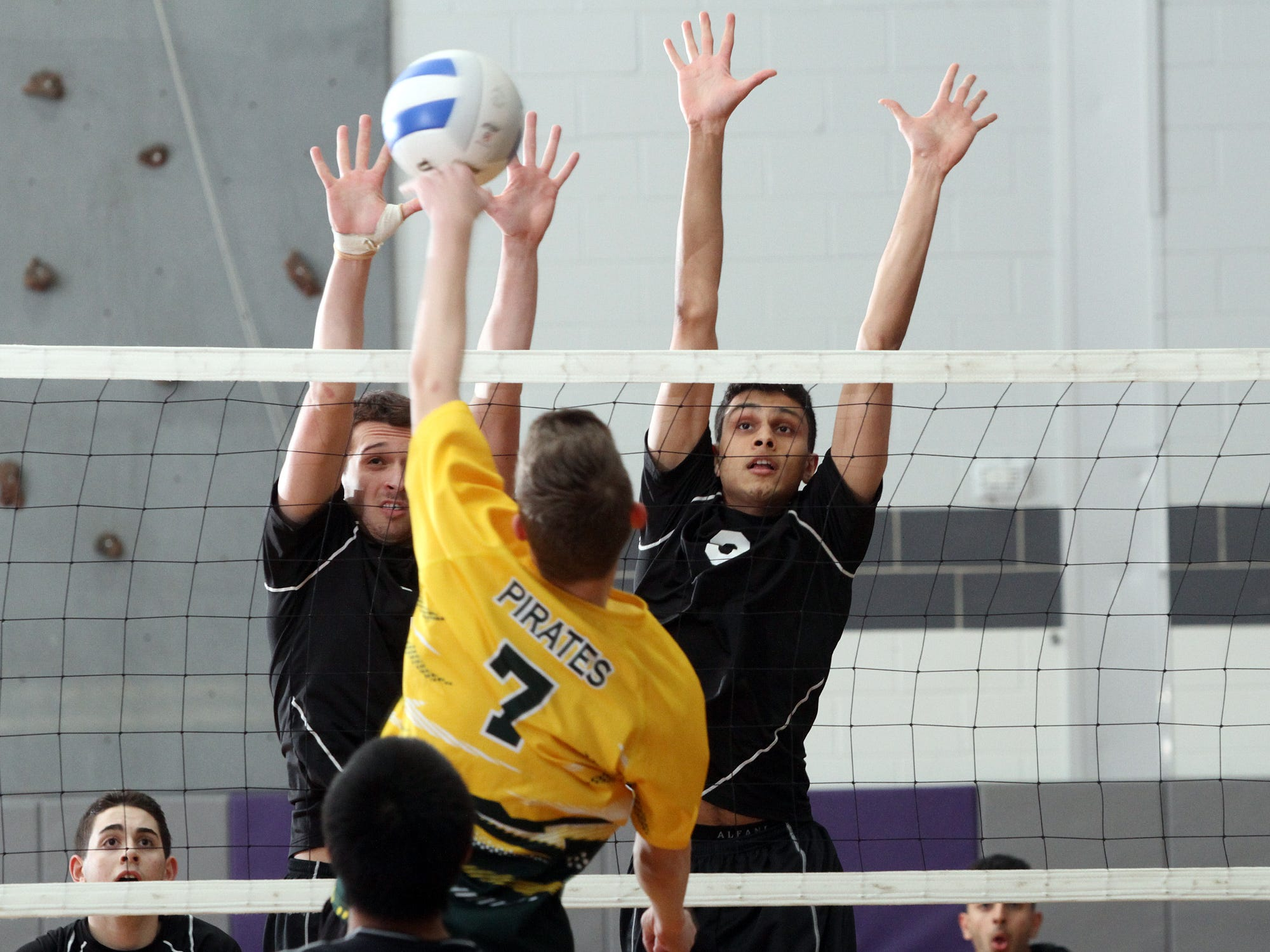 Robert Meyer (left) and Dhruv Patel of Old Bridge look to block a shot by West Windsor-Plainsboro's Jon Asay, Tuesday, April 21, 2015, in Old Bridge, NJ.
