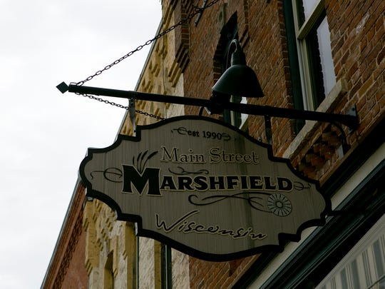 Main Street Marshfield's sign hangs outside its South Central Avenue location in downtown Marshfield.
