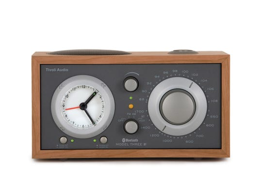 The Model Three BT AM/FM alarm clock radio sports an analog clock and can be connected to audio devices via an audio jack or a wireless Bluetooth connection.