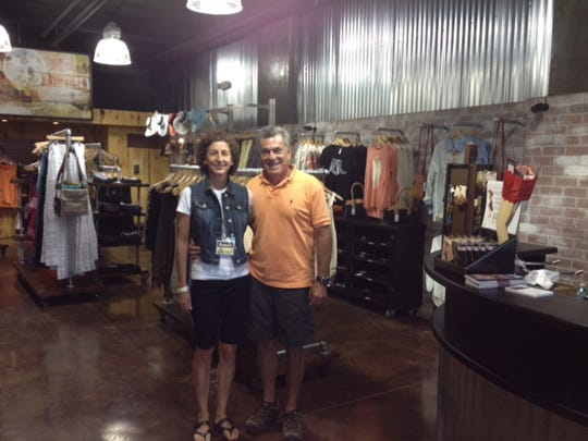 """Geff and Sandy Lee own and operate Ensemble a """"luxury for less"""" store in downtown Nashville."""