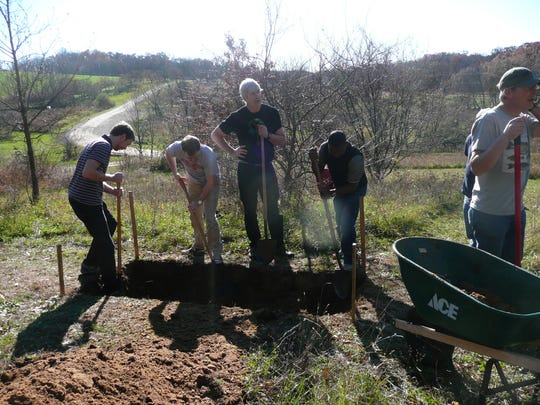 Loved ones prepare Gene Farley's grave last year at Natural Path. The cathartic experience of Gene's wife's natural burial in 2009 spurred the family to open the sanctuary in 2011.