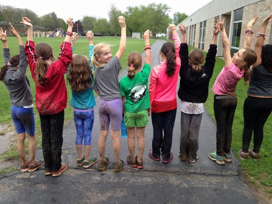 French Road School students are proud of their mud.