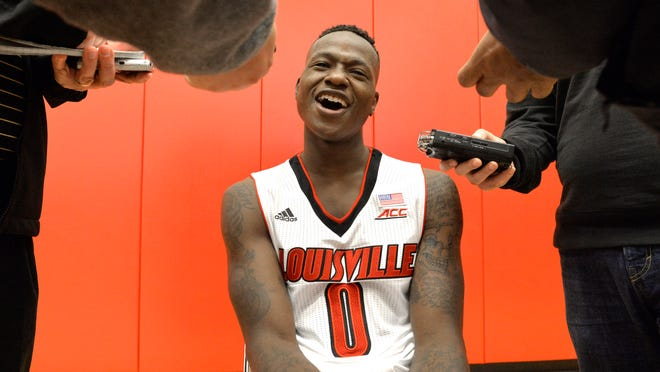 Louisville sophmore Terry Rozier answers questions from reporters during the team's Media Day, Sunday, Oct. 19, 2014,  in Louisville, Ky. (AP Photo/Timothy D. Easley)