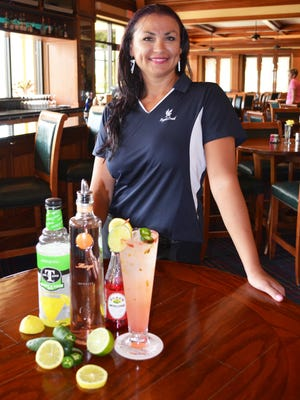 """Angelina McLean, head bartender at Eagle Creek Golf & Country Club, won the grand prize in national mixology contest for her original concoction titled the """"Mango Tango."""""""