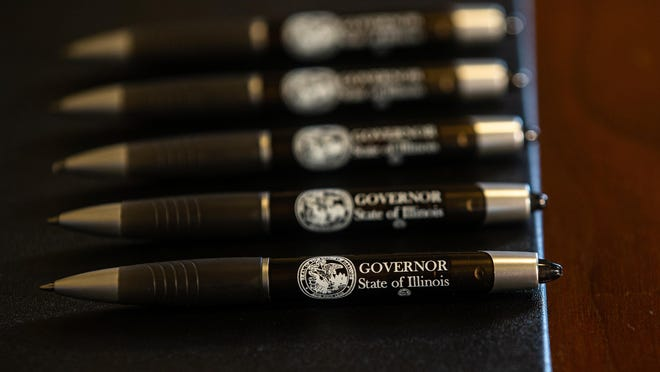 Pens are lined up for Illinois Governor J.B. Pritzker to sign legislation raising the minimum salary for teachers to $40,000 during a bill signing ceremony in the Governor's office at the Illinois State Capitol, Thursday, Aug. 22, 2019, in Springfield, Ill. The new new minimum salary will be phased in over four years with hopes to reduce a teacher shortage in Illinois that has school districts for the 2018-2019 school year with 4,196 unfilled positions across the state according to the Illinois State Board of Education.