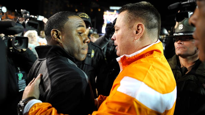 Vanderbilt coach Derek Mason, left, and Tennessee coach Butch Jones meet at midfield after Tennessee defeated Vanderbilt 24-17.
