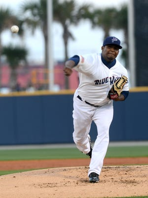 Pensacola Blue Wahoos pitcher Carlos Contreras winds up on the mound Thursday in a game against the Mississippi Braves at Blue Wahoo Stadium.