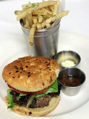 The steakhouse hamburger and truffle fries are new menu items you'll find at Ruffino's on the River.