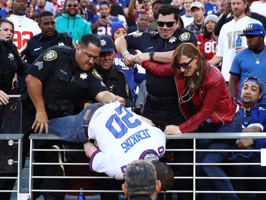 A fan fights with police and is detained during the NFL game between the San Francisco 49ers and the New York Giants at Levi's Stadium on November 12, 2017 in Santa Clara, California.