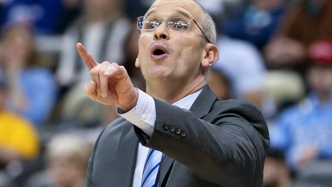 Rhode Island head coach Dan Hurley yells to his team as they play in an NCAA college basketball game in the Atlantic 10 tournament championship, Sunday, March 12, 2017, in Pittsburgh. (AP Photo/Keith Srakocic)
