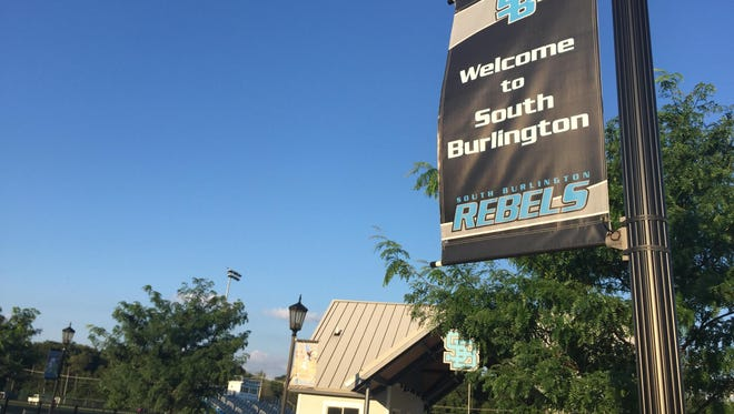 """A sign on the South Burlington High School campus with the word """"Rebels"""" on the bottom."""