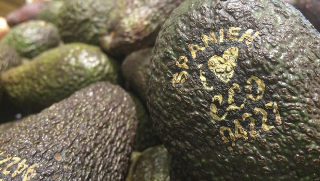 Laser branded avocados are displayed at the ICA Kvantum supermarket in Malmo, Sweden.