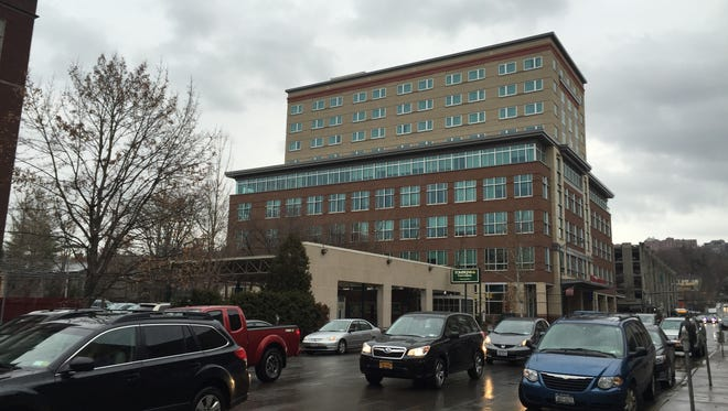 Tompkins Financial has proposed a new seven-story headquarters building on the site of its Seneca Street branch next to the Hilton Garden Inn in downtown Ithaca.