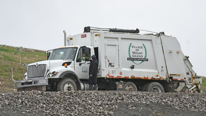 A Village of Mount Gilead truck driver is stopped by authorities on Tuesday at the Crawford County Solid Waste Management District and Recycling Center grounds as law enforcement agencies conduct a search.