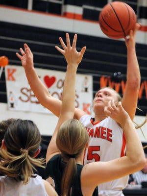 Gracey Damron sinks a left-handed hook shot for Kewanee in a girls basketball game on Monday against St. Bede.