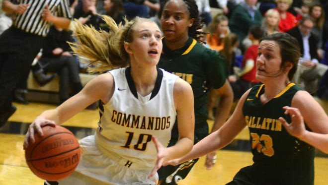 Hendersonville High sophomore guard Brooke Long drives to the basket as Gallatin junior Savannah Link (23) defendsd during second-quarter action. Long scored 19 points.