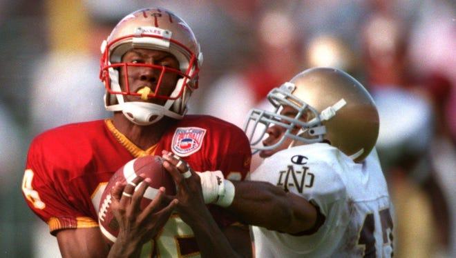 FSU's Kez McCorvey makes a catch against Notre Dame. McCorvey was hired as St. John Paul II Catholic School's next football coach.