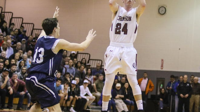 Morristown-Beard's Brian Monaghan makes a pass as Chatham's Chris Conlin defends during the first half of the Morris County Tournament boys basketball final at County College of Morris in Randolph on Saturday.