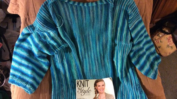 Here's my version of the side-to-side cardi that was on the cover of Knit 'N Style magazine back in 2009. My construction is different, but I like how it's coming out.