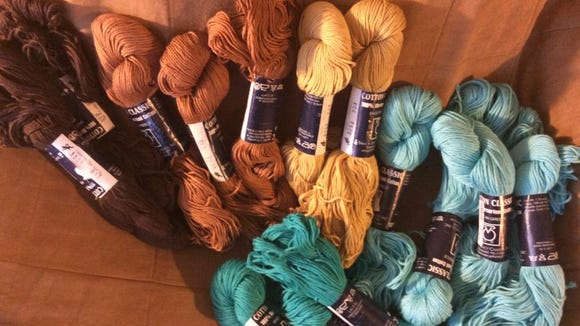 At the bottom of this photo are the 3 new hanks I ipicked up at Yarn Attic on the Wool Walk, positioned next to the hanks from my stash that, in my opinion, go best with them colorwise.