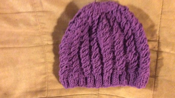 Have you tried this cabled chemo cap yet? The pattern is in my last blog post: https://www.mycentraljersey.com/story/life/arts/crafts-hobbies/in-stitches/2017/08/02/using-knitting-as-an-escape-free-hat-pattern/104216322/