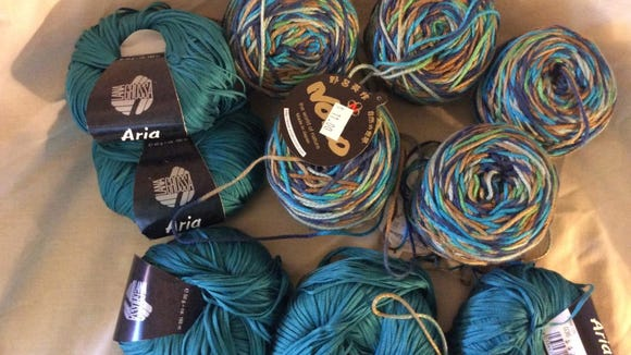 The variegated yarn is Noro in a cotton-silk blend. The Aria, which is one of my few purchases this year, was purchased on the NJ Wool Walk at the Yarn Attic.