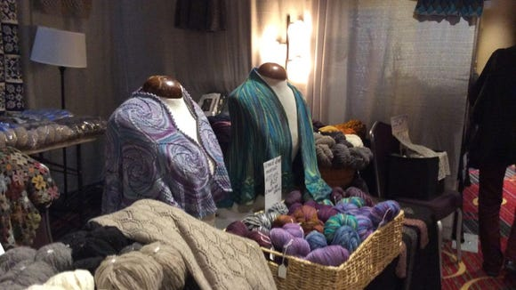 I particularly liked the garments on display in this Marketplace booth at Vogue Knitting Live. They were made with this vendor's yarns.