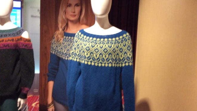 This is the yoke sweater that Deborah Newton designed for the Winter 2017/18 issue of Vogue Knitting, which I've started to make for myself. Here's the actual sweater on display at Vogue Knitting Live, in front of a poster-sized photo of the same sweater.