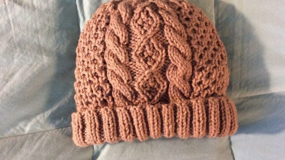 This hat as double-length ribbing, wider cables and smallerdiamonds.