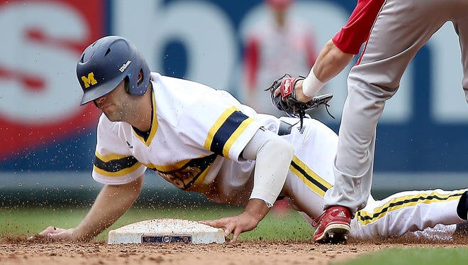 Michigan's Jackson Glines slides safely into second base despite Indiana's Casey Rodriguez's efforts in the sixth inning at Target Field on Wednesday, May 20, 2015, in Minneapolis.