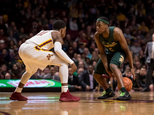 Michigan State Spartans guard Cassius Winston (5) dribbles