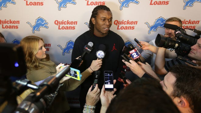 Detroit Lions defensive end Ziggy Ansah talks with reporters during a news conference in Allen Park on Thursday, May 5, 2016.