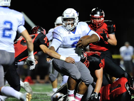 Wallington running back Elijah Mitchell looking for some space against Emerson on Friday, Oct. 6, 2017 in Emerson.