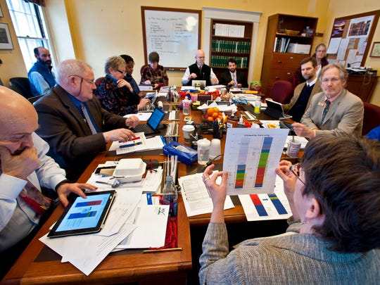 Robin Lunge, the state's director of health care reform (right), testifies on Gov. Shumlin's proposed health care initiatives before the House Health Care Committee at the Statehouse in Montpelier on Wednesday, February 4, 2015.