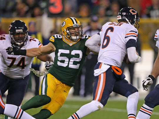 Packers linebacker Clay Matthews pressures Bears quarterback Jay Cutler.