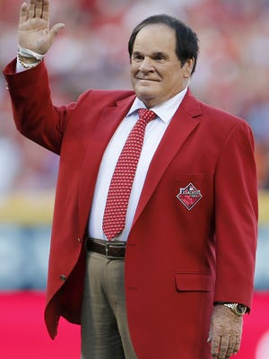 Reds great and MLB all-time hits leader Pete Rose waves to the crowd as he is recognized as one of the Franchise Four ahead of the 2015 MLB All-Star Game, Tuesday, July 14, 2015, at Great American Ball Park in Cincinnati.