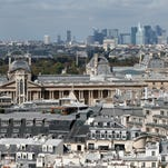 A picture taken on September 15, 2012 in Paris shows a general view of Paris, and Paris' skyline of La Defense business district, viewed from the top of the Saint Jacques Tower (Tour Saint Jacques), opened for the first time to public, during the 29th edition of France's European heritage open days. France opens the doors of its state buildings, some usually forbidden to the public, during these European heritage days until September 16. AFP PHOTO / KENZO TRIBOUILLARD        (Photo credit should read KENZO TRIBOUILLARD/AFP/Getty Images)