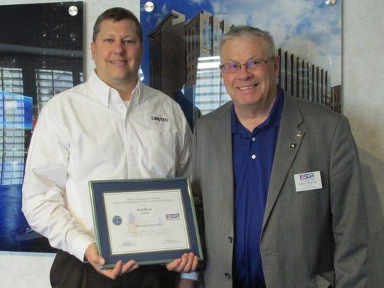 Paul Bratz, left, receives Patriot Award