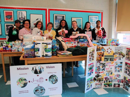 As the result of a recent gift auction at Mother Seton Regional High School in Clark, a number of items were collected for Josephine's Place, a women's shelter in Elizabeth. Left to right are: Mother Seton's Parents' Guild members:  Stephanie Mars, Vivian Marticorena, and Lynn Mikolay; Sister MaryAnne Katlack, campus minister at Mother Seton; and students Bianca Ortega, Jenna Mikolay, Isabela Marticorena, and Shavonne Watlington.