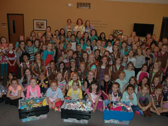 More than 130 girl scouts got together recently for the first annual Cupcake Wars and to put together chemotherapy bags for cancer patients.